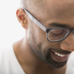 Close up of man in eyeglasses looking down